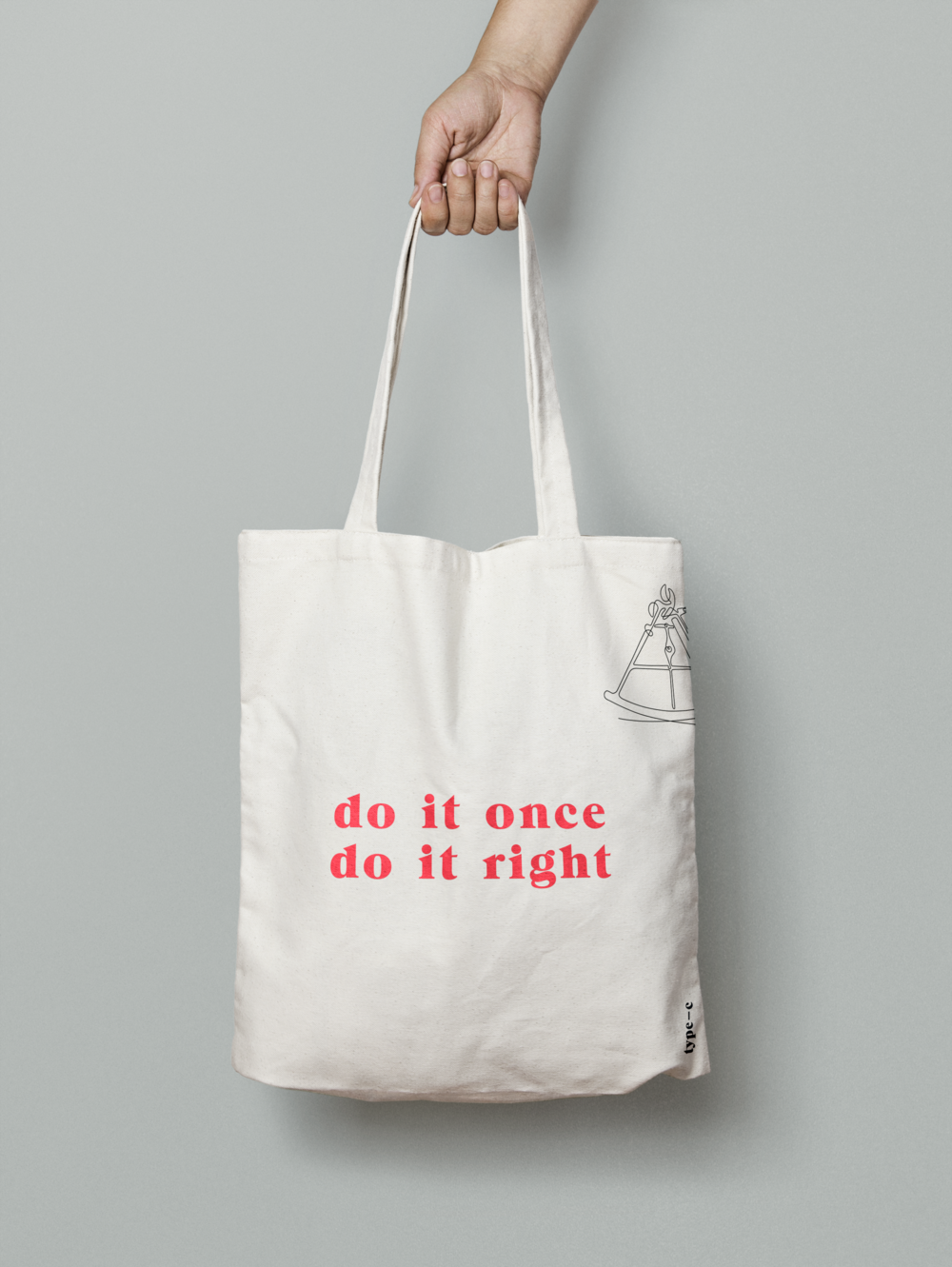 Do it once, do it right tagline on a tote bag for Type C Consulting.png