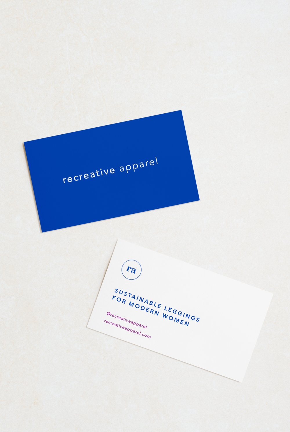 Recreative Apparel business cards in bright royal blue on a white background