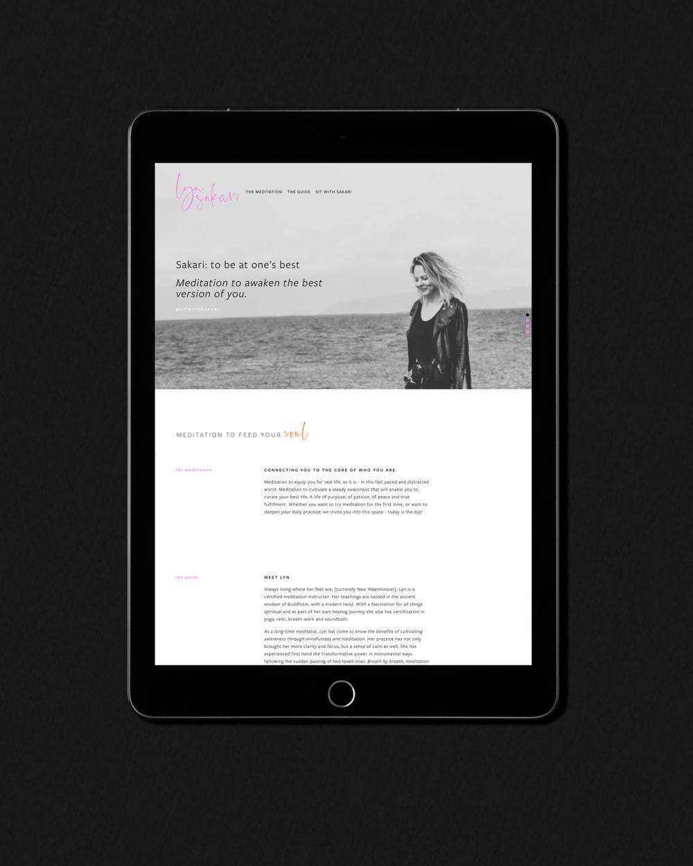 Lyn Sakari website shown on an iPad on a black background