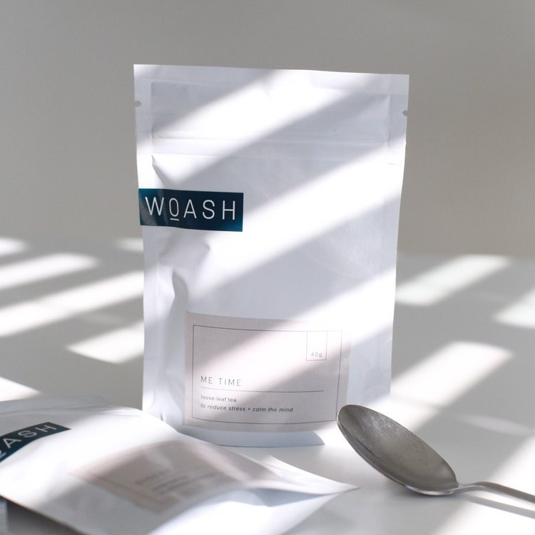 Woash Wellness packaging showing with sunlight streaming through a window