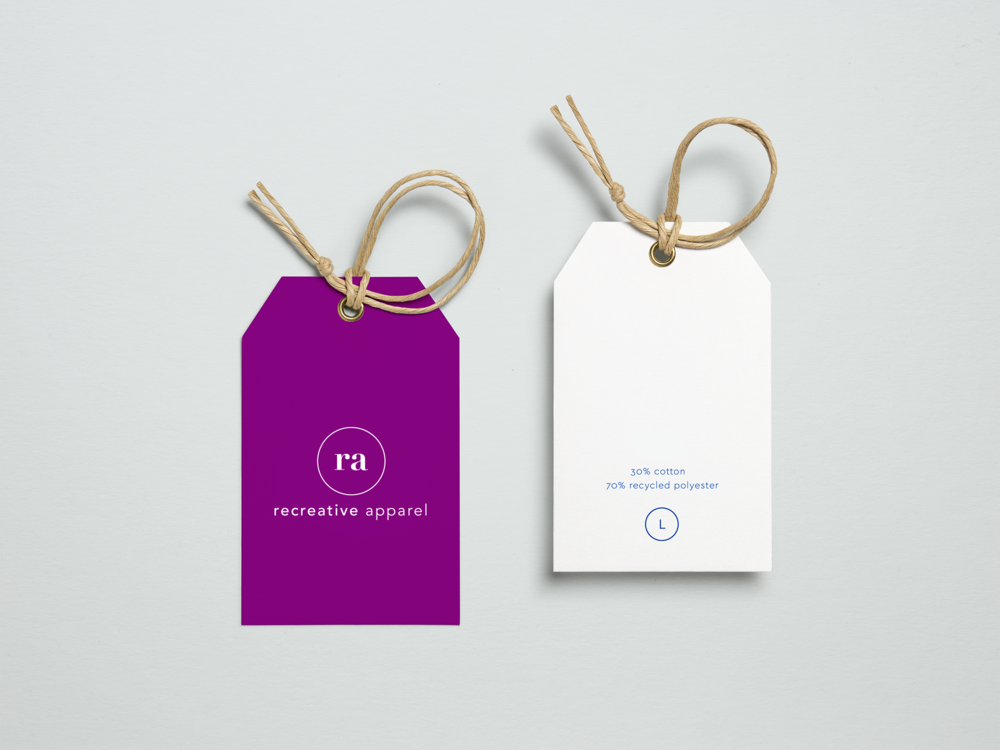 Recreative Apparel clothing tags with the icon monogram and wordmark logo on a purple background.