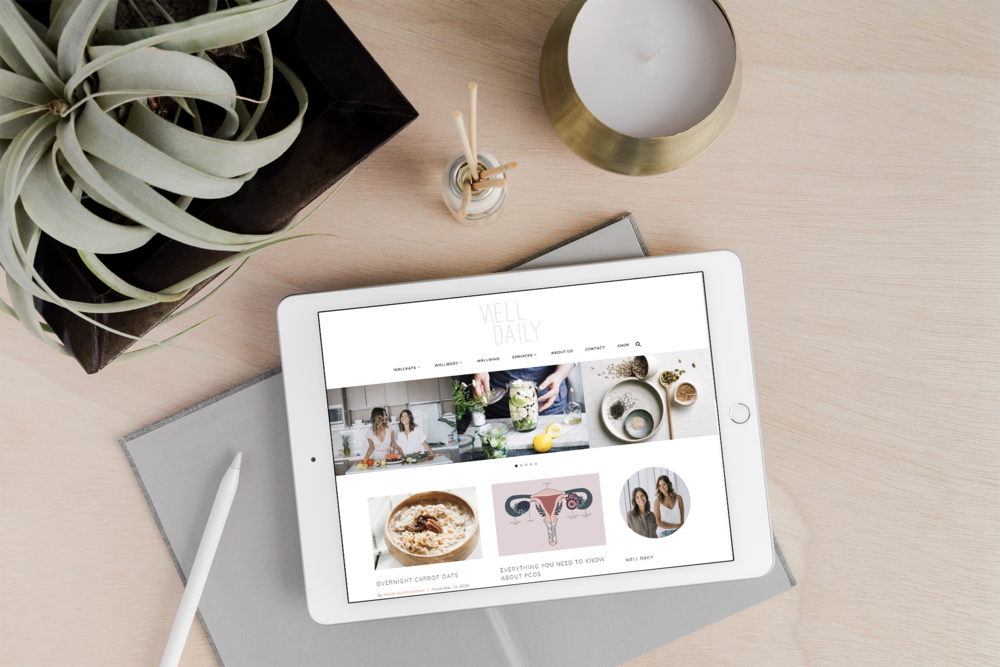 Well Daily website on an ipad. Logo and branding by Salt Design Co.