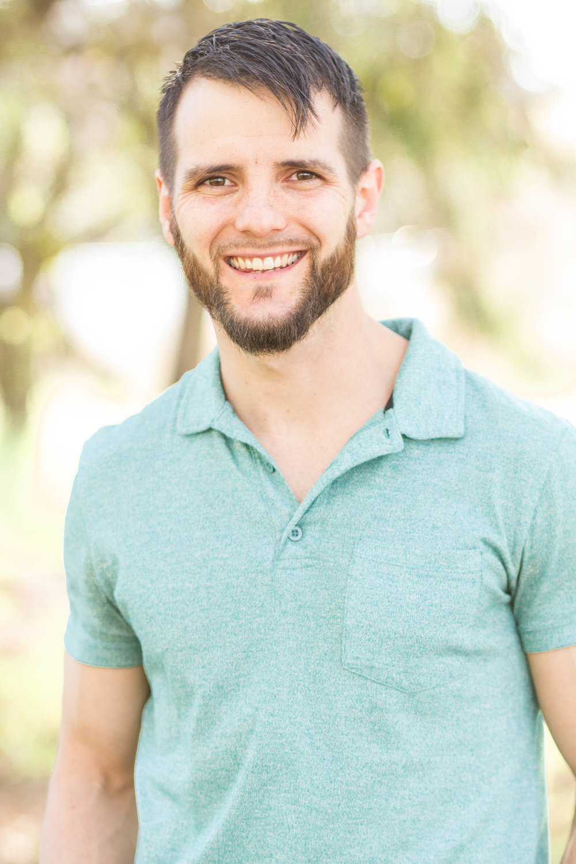 josiah head shot - green shirt.jpg