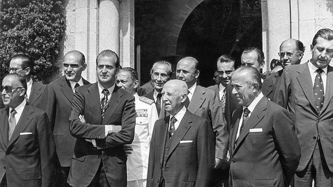 Juan Carlos I, Franco y Arias Navarro.