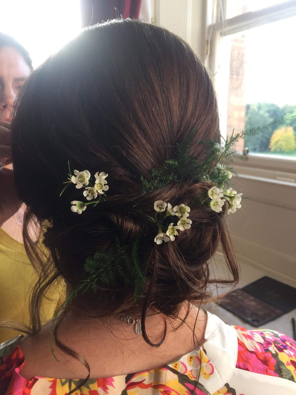 Monica placed fresh flowers on her natural looking hairstyle (it was full of Elnett but looked natural)!