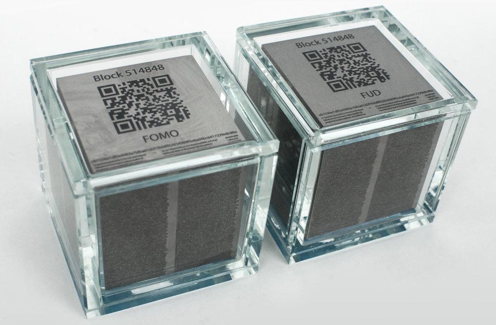 """The sculptures """"FOMO Block 514848"""" and """"FUD Block 514848"""""""