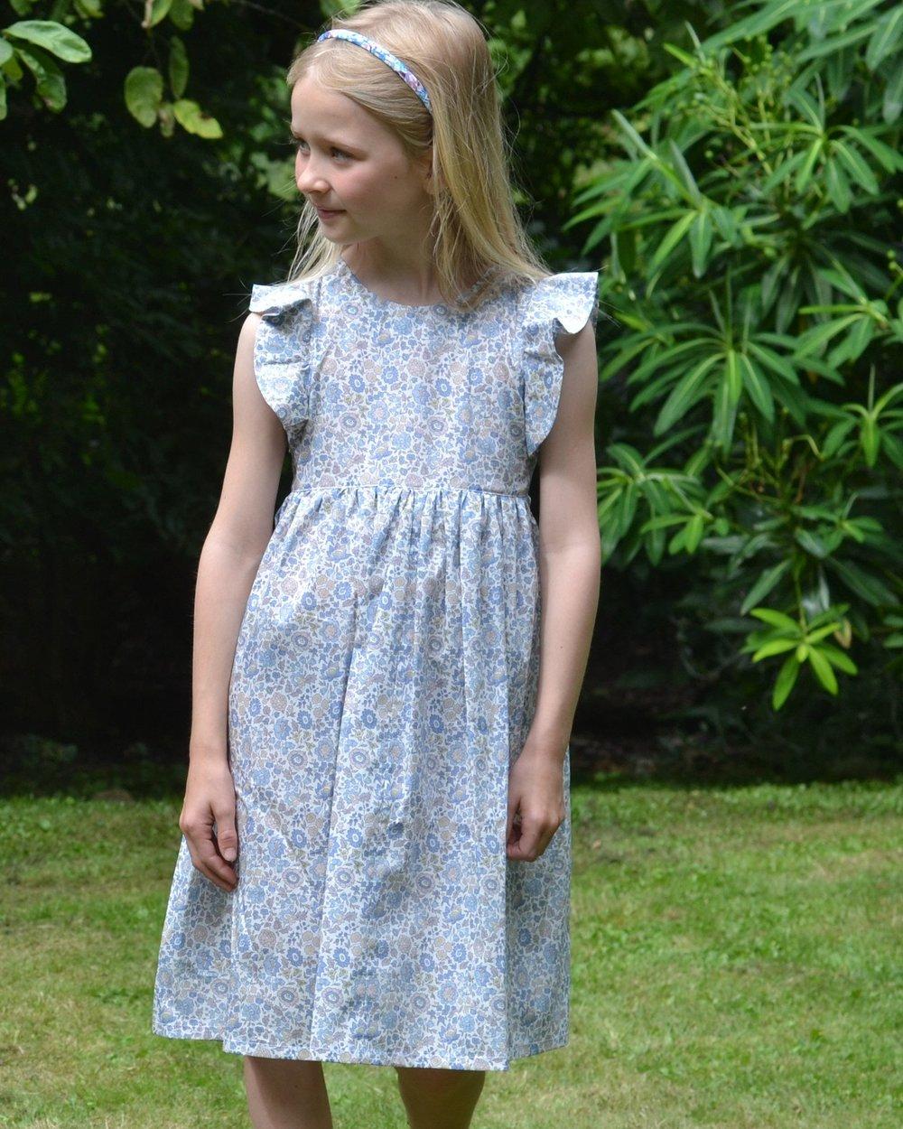 milliemanu-blue-d_anjo-liberty-print-araminta-girls-dress-lifestyle.jpg