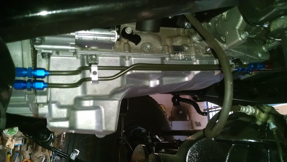 All fluid lines use AN fittings for ease of service.  Fittings shown allow removal of motor or trans without long trans cooler lines to contend with.