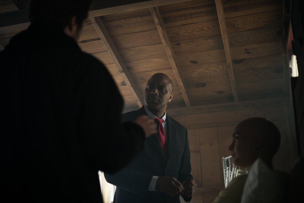 Atticus Cain (pictured center),Dannah Basgall (pictured right), and dir. Grayson whitehurst discuss a scene on the third day of shooting.