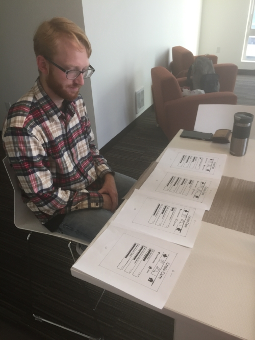 A Seattle citizen testing our paper prototypes.