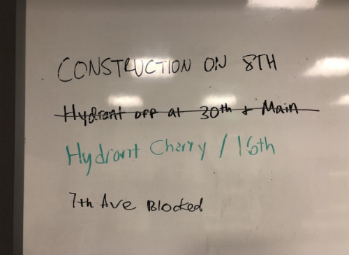 Whiteboard in the front office of the station where firefighters write down information they hear through word of mouth about road obstructions and closures and fire hydrant shutoffs.
