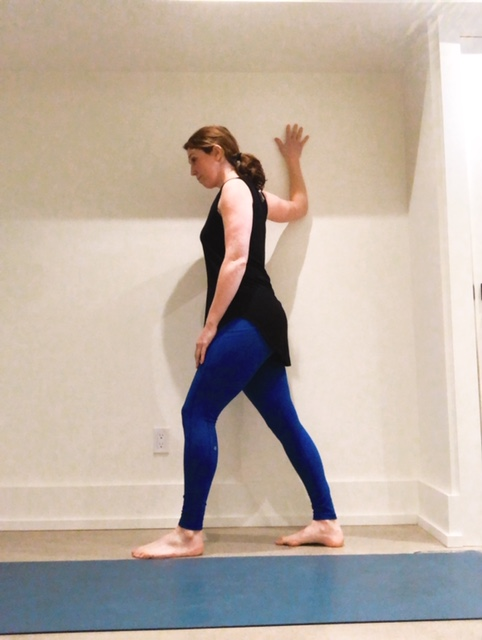 single arm chest stretch on wall -
