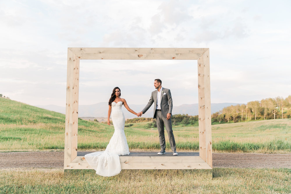 Photography: Valorie Darling, Venue: Flying Diamond Weddings, Custom frame: David Beahm Experiences, Dress: Inbal Dror, Suit: Custom Elevee, Shoes: Custom Converse