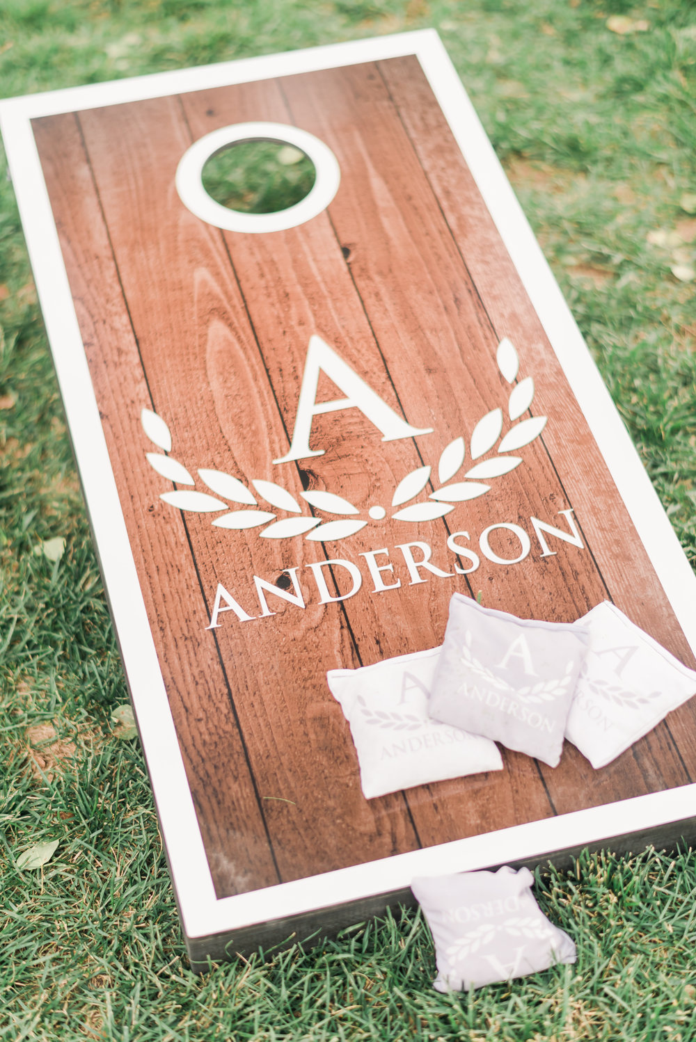 Pre-ceremony and cocktail hour corn hole boards. Custom boards by: Victory Tailgate