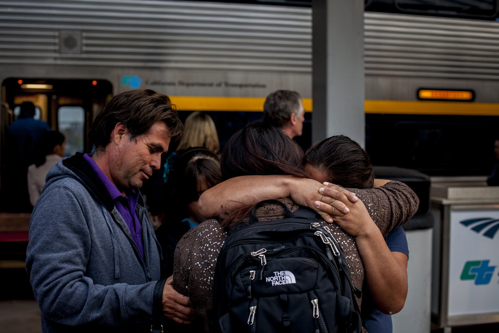 Blanca's parents and sister embrace and cry with joy upon seeing their daughter arrive at the Bakersfield Amtrak station for Thanksgiving break during Blanca's second semester at UC Berkeley. The family is always overjoyed to see their first born. Photographed on November 26, 2013.