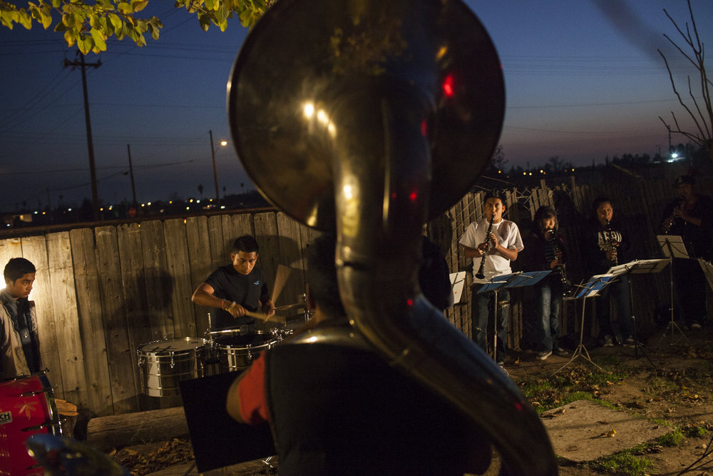 "A ""banda"" practices in the early evening in Blanca's Bakersfield, CA neighborhood near her family's home. Photographed on December 1, 2013."