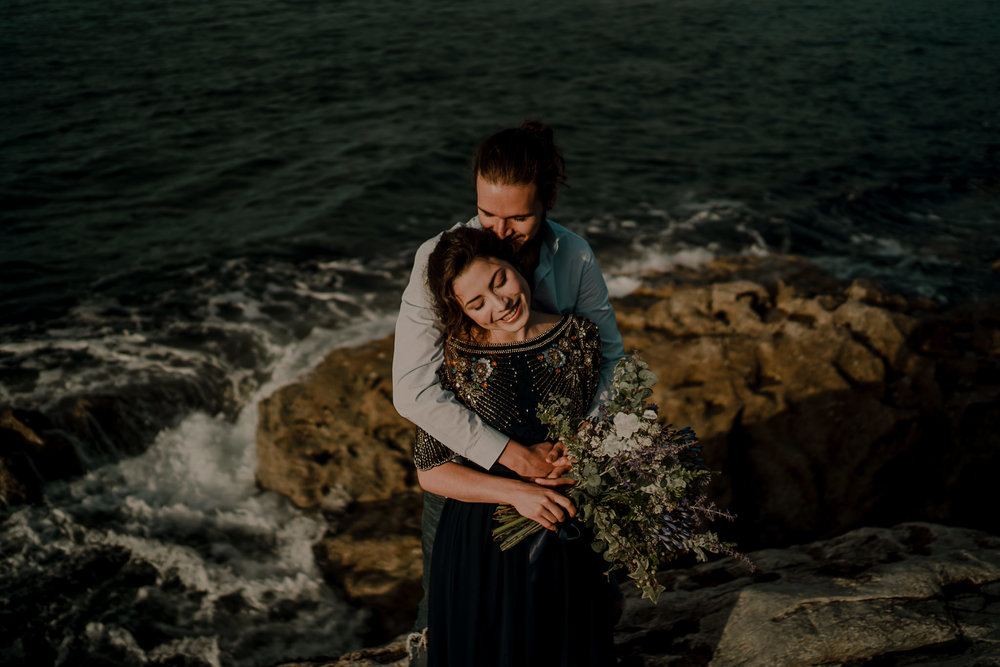 couple hugging during their pre wedding engagement photoshoot on the North Coast of Ireland