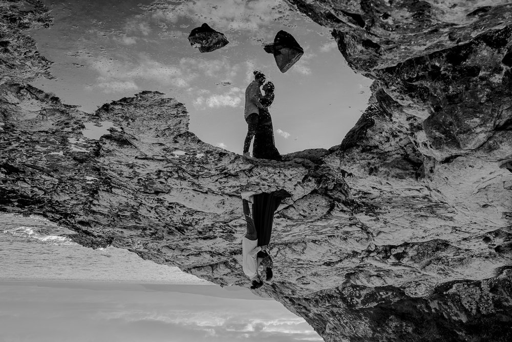 the upside down creative reflection during a couples engagement shoot on the causeway coast