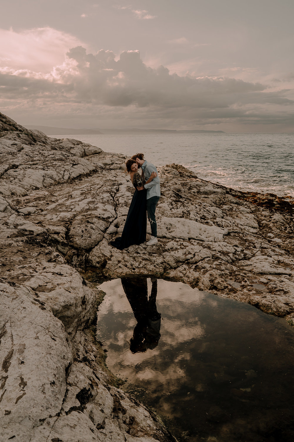 reflection in the rock pools on the causeway coast engagement photography