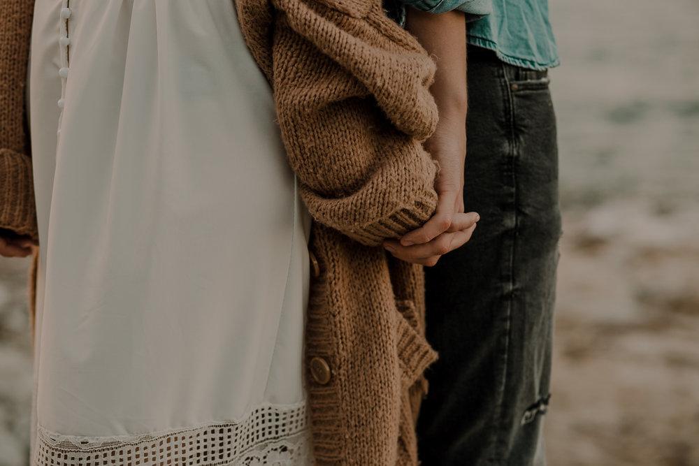 details couple holding hands causeway coast
