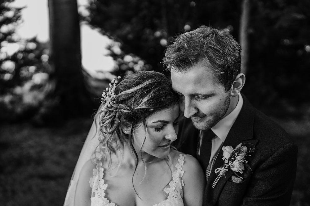 bride and groom in secret garden northern ireland wedding photographers