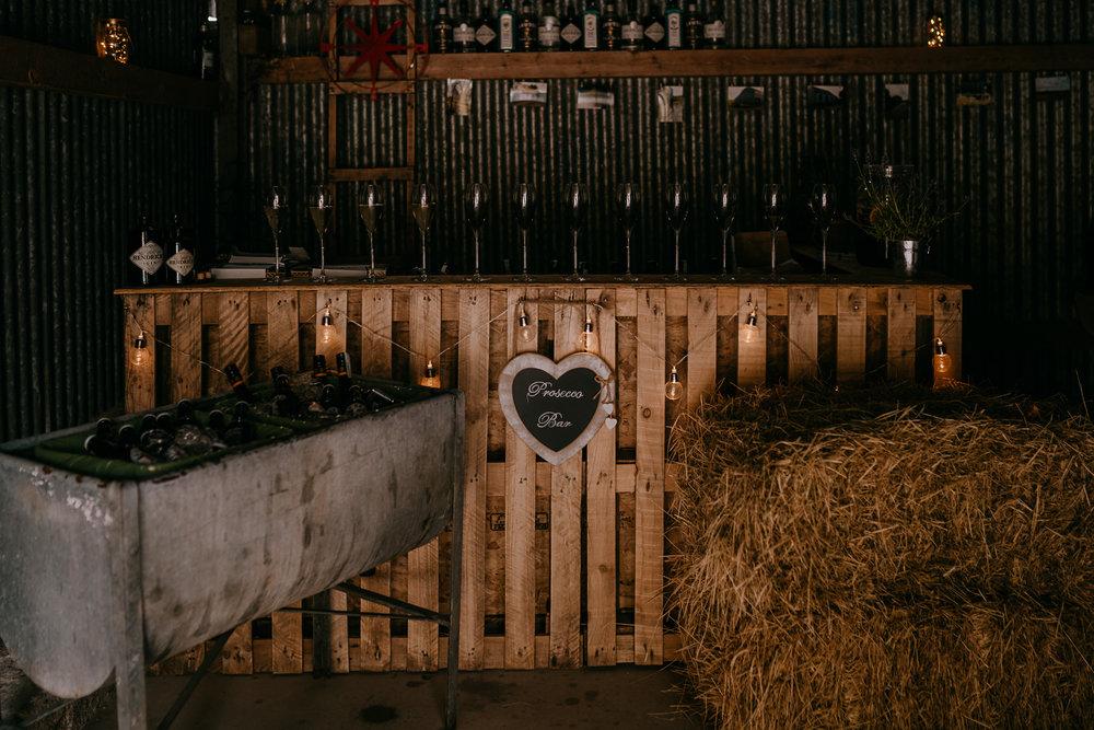 french village barn wedding Bar set up rustic Northern Ireland wedding photographers