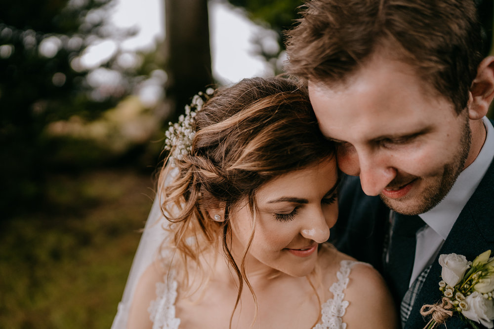 beautiful moment between bride and groom in secret garden Northern Ireland wedding photographers