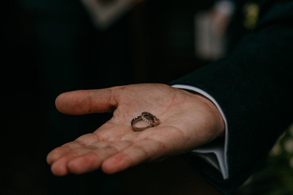 groom holding wedding rings in palm Northern Ireland Wedding Photographers