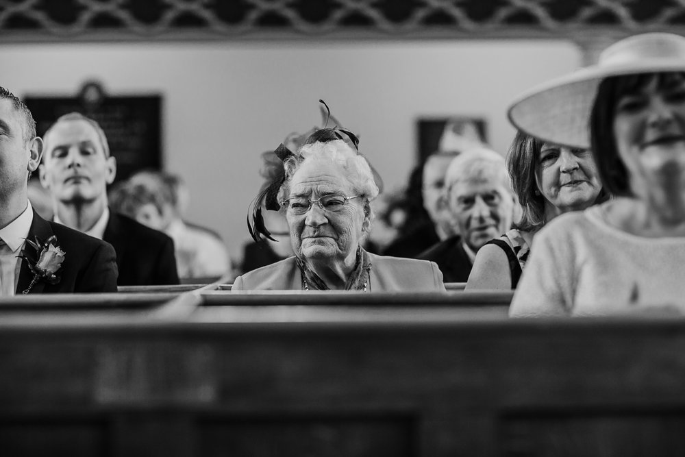 grandmother in church Northern Ireland Wedding Photographers