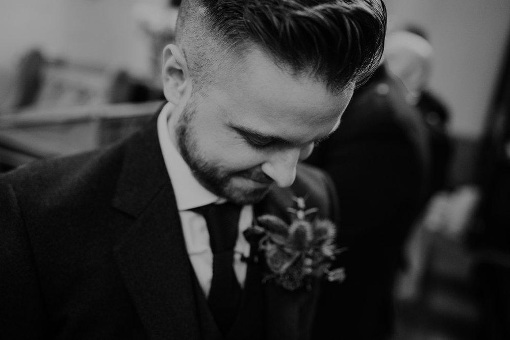 groom first look emotional wedding