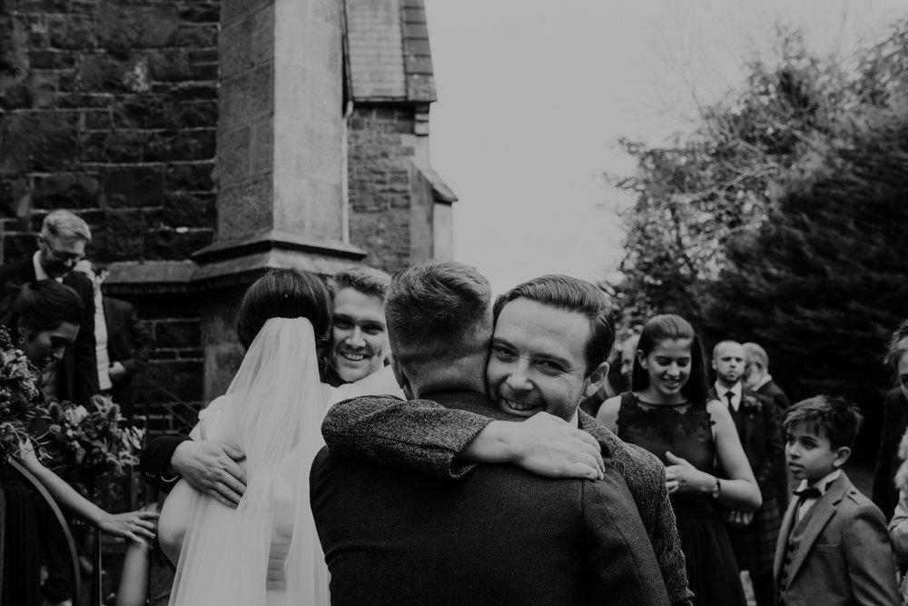 hugging guests wedding at lissanoure castle