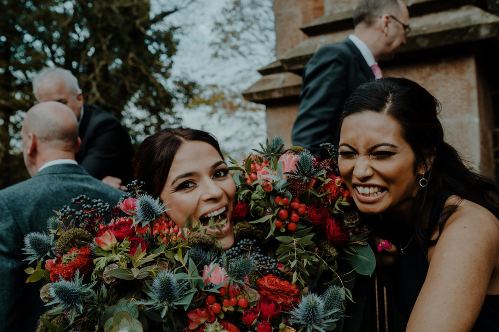 bridesmaids having fun with flowers  wedding at lissanoure castle