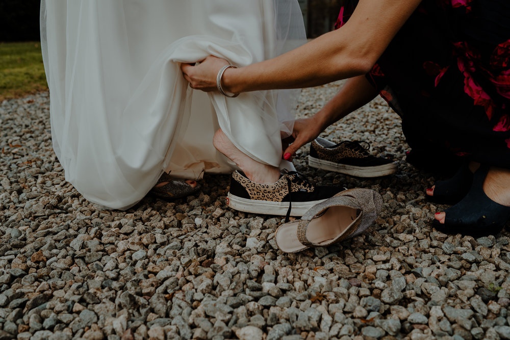 bride puts on vans  wedding at lissanoure castle