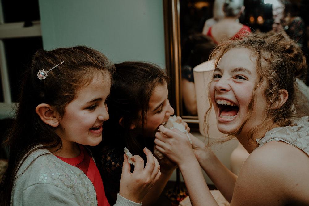 guests enjoy cake  wedding at lissanoure castle