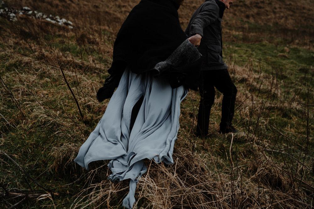 wanderlust rustic elopement northern ireland wind swept dress kinbane castle