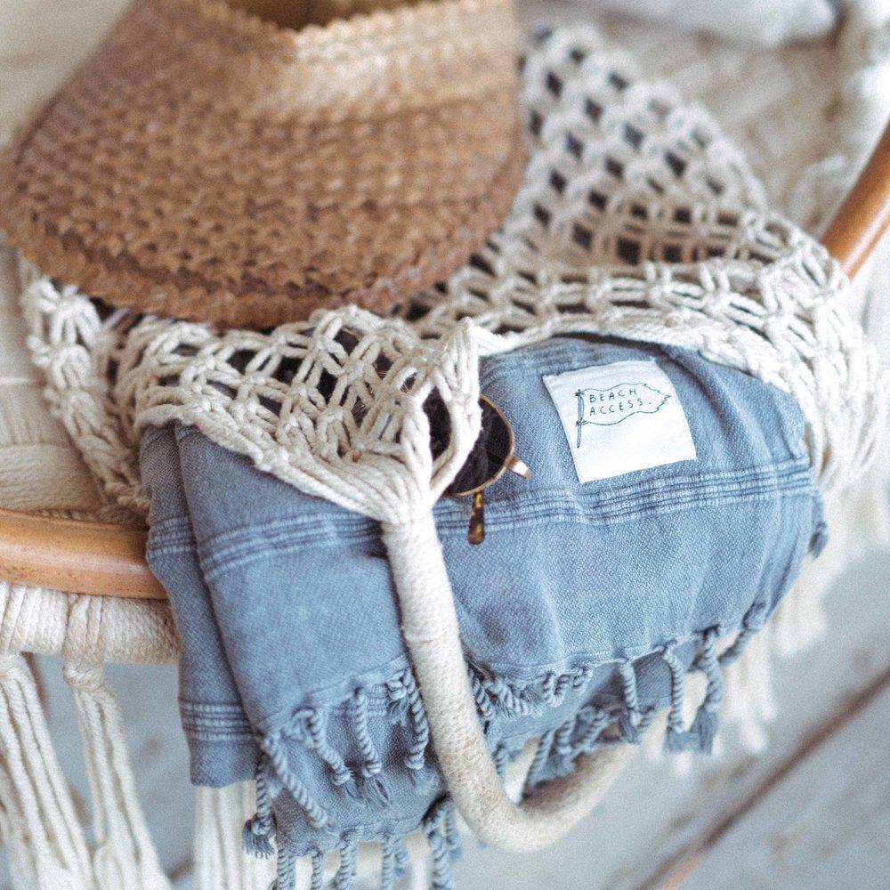 'Surf' visor, 'Tide' bag + 'Good Vibrations' towel.