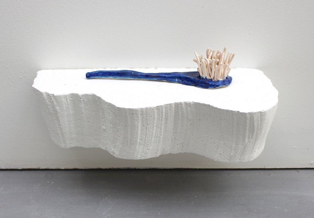Blue brush , glazed ceramic, polystyrene shelf, 2018