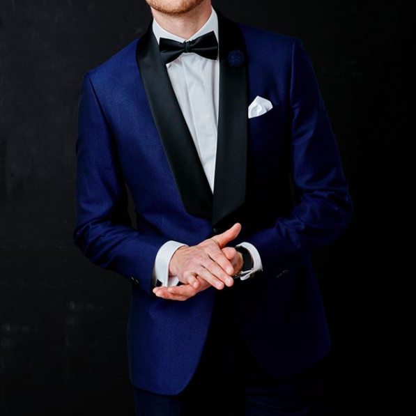 Change it up with a blue tuxedo jacket. As a guest at a black tie optional event, a blue tux jacket with matching or black tux pants is awesome. Tuxedo by  Surmesur .