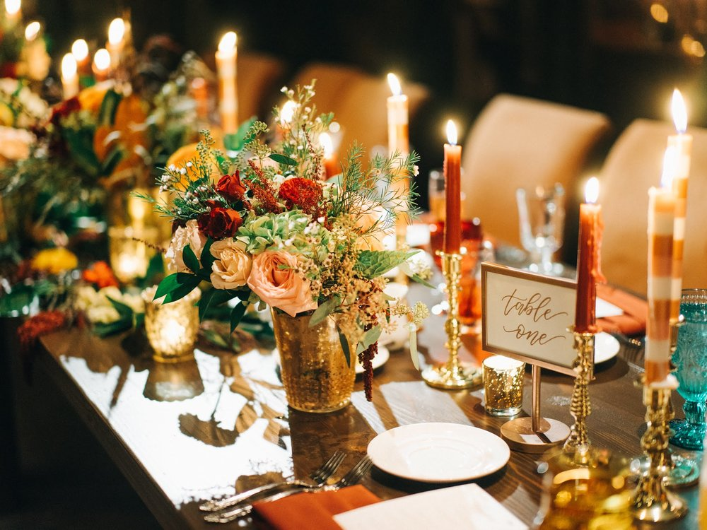 Votives, candle holders and detailed candles can really make your tablescape POP! Credit:  Sean Cook Weddings