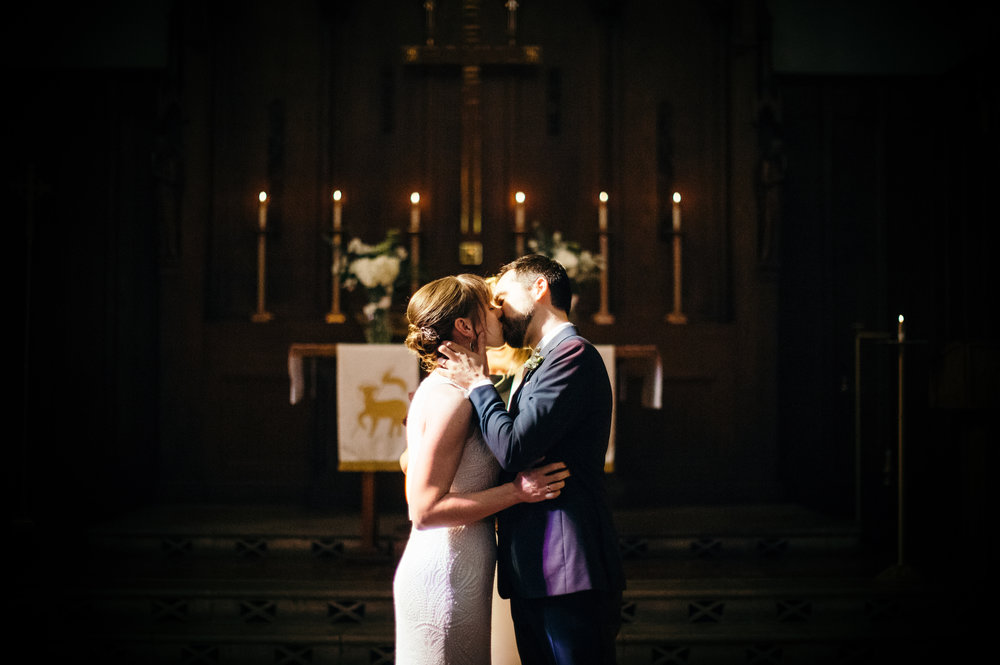 Bride andGroom First Kiss Chicago Church Wedding Dorey Kronick