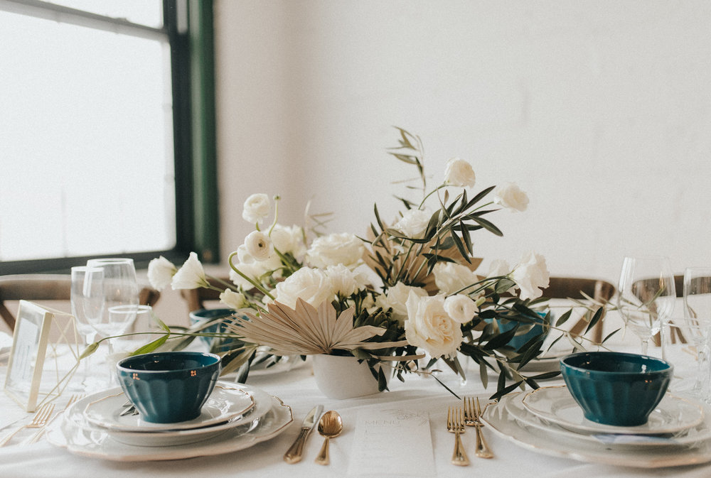 Centerpiece by  Skyvanah , table styling by  Olive Fine Weddings  and  Stone Fruit Studio , photo by  RachelLiz Photography .