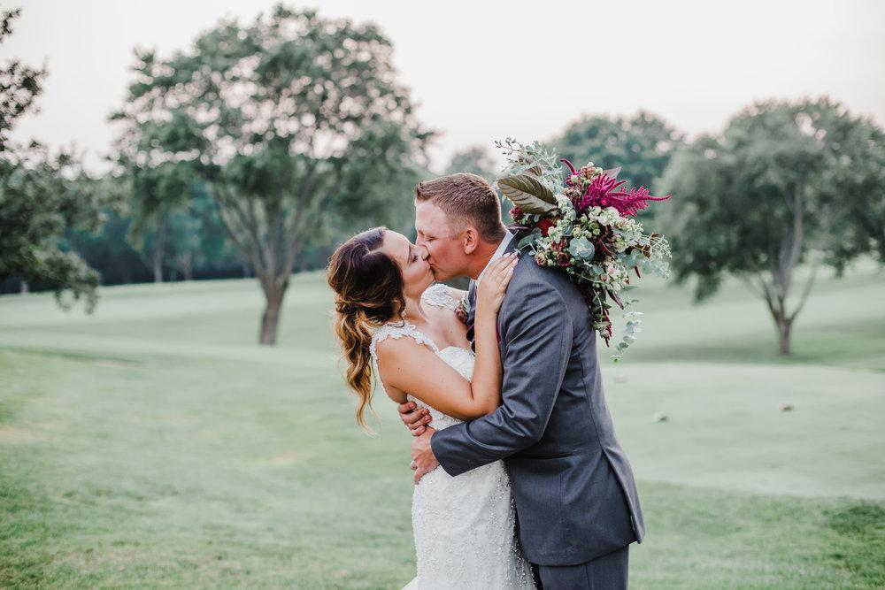 Bride and Groom Kiss Chicago Wedding Grey Garden Creative