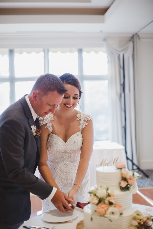 Bride and Groom Cutting the Cake Chicago Wedding Grey Garden Creative
