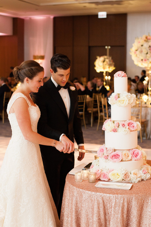 Bride and Groom Cut the Cake Chicago Wedding Emilia Jane Photography