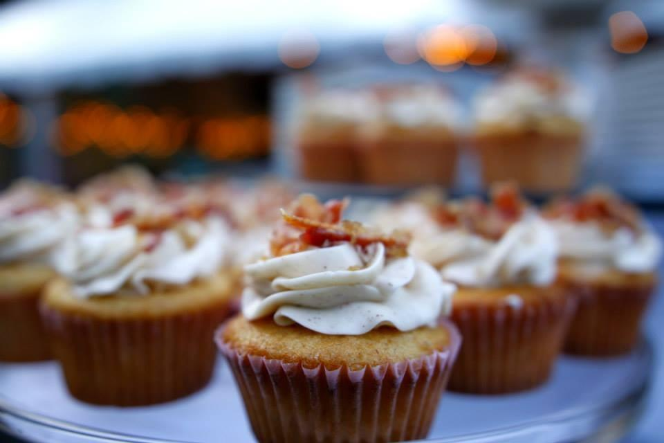 Maple cupcakes with cinnamon frosting and candied bacon.