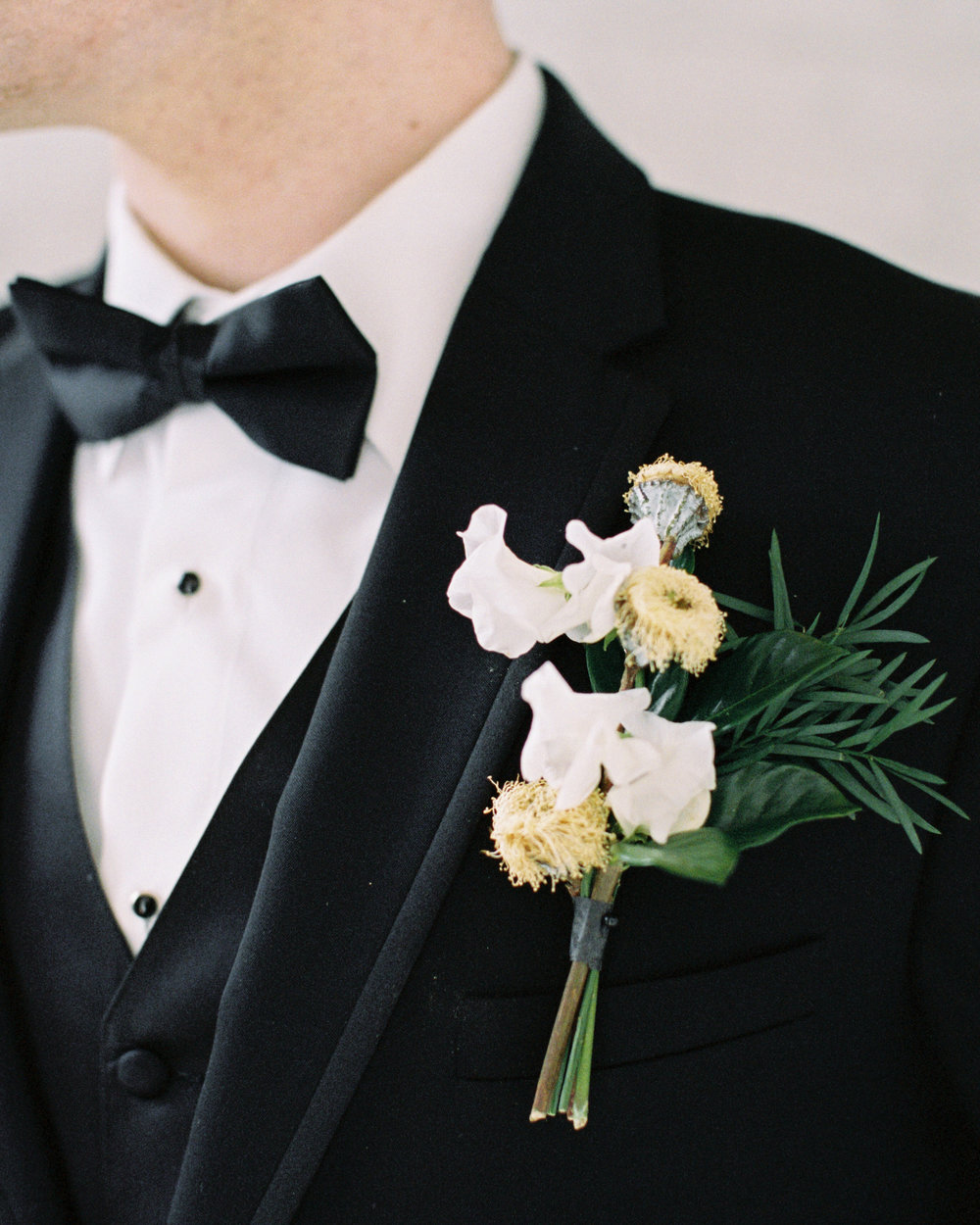 Grooms attire with boutonniere at modern wedding venue with lots of natural light, and beautiful greenery for this Chicago wedding styled shoot. Find more wedding inspiration at chitheewed.com!