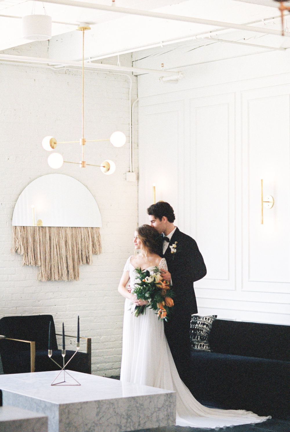 Boho bride and groom pose for wedding photos at modern wedding venue with lots of natural light, and beautiful greenery for this Chicago wedding styled shoot. Find more wedding inspiration at chitheewed.com!