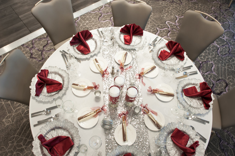 Elegant ballroom wedding with deep reds and silver accents at the White Eagle Golf Club in Naperville, IL captured by Elite Photo. Find more unique wedding ideas at CHItheeWED.com!