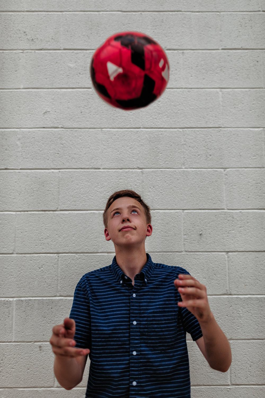 senior-photography-austin-mn-minnesota-family-kids-seniors-photo-session-albert-lea-mn-rochester-mn-southern-minnesota-photographer-high-school-photography-graduation-pictures-downtown-soccer