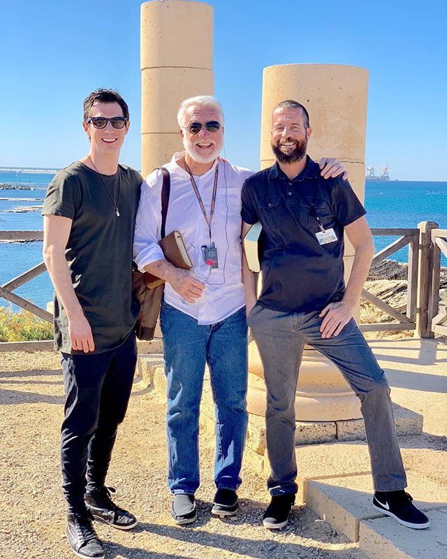 ❤️ my Dad and bro. Honestly it's really special speaking everyday in Israel alongside these two titans! After this gorgeous amphitheater expedition to Caesarea we went to Mt. Carmel and I talked about Elijah on site☄️☄️The old stories tell us Elijah was an OG: here's a guy who could outrun horses, ride chariots of fire up to the heavens, raise the dead, and summon dragon ball z fireballs from the sky. When he was at the pinnacle of prominence and prosperity, doing his mightiest miracles, RAVENS fed him and a WIDOW sustained him, but when he went through his dark day of doubt and despair, ANGELS fed him and GOD Himself sustained him. When Elijah was at his lowest God updated his grace to Provision 2.0. God is so generous he sometimes will work even more through our doubts than through our faith. Yup. He's really that good. 😇 🦅 🤘🏻 🌈 👨‍🍳 . . . . . . . #israel #godisgood #hopeisdope #godofhope #writersofinstagram #writerscommunity #author -#authorsofinstagram #dailyhope #life #hope #tour #speakerslife #lovemyfamily #